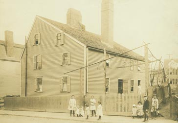 Exterior view of Gedney House with children standing on street, Salem, Mass.